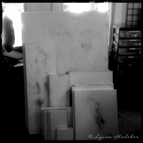 20+ canvases/wood panels, textured, painted white and waiting...