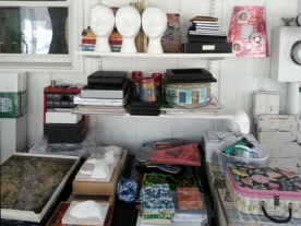 """shelving above the """"work in progress"""" storage area (flat paper is stored underneath)"""