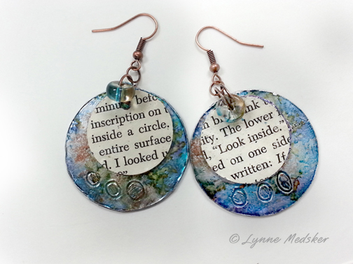 Earrings from packaging envelopes and old book pages, SOLD © Lynne Medsker