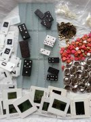 Slides, various dominoes, beads from jewelry, tacks, metal buttons, alphabet tags, glass tiles