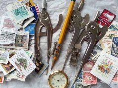 old stamps, old watch piece, old compasses