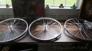 Unpainted wheels, lined up and waiting