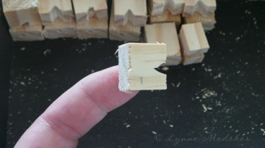 Tiny wood pieces, used to attach the wires to the wheels