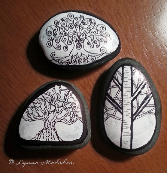 Trees painted on stones © Lynne Medsker