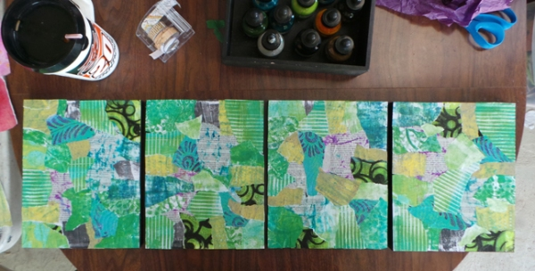 Work in progress, applying book pages and gelli prints to wood panels
